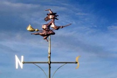 Weathervane of a witch made of copper highlighted in gold leaf