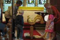 Cock Weathervane Being Blessed before being placed on the spire, Hand made and finished in gold leaf