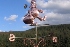 Chimney sweep weathervane off home after a long day